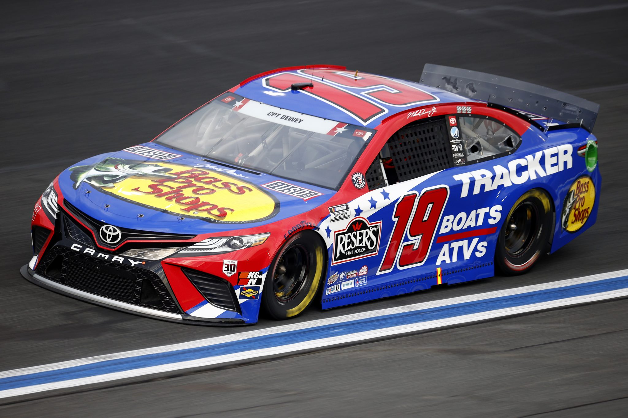 CONCORD, NORTH CAROLINA - MAY 28: Martin Truex Jr., driver of the #19 Bass Pro Shops Red White Blue Toyota, drives during practice for the NASCAR Cup Series Coca-Cola 600 at Charlotte Motor Speedway on May 28, 2021 in Concord, North Carolina. (Photo by Jared C. Tilton/Getty Images) | Getty Images