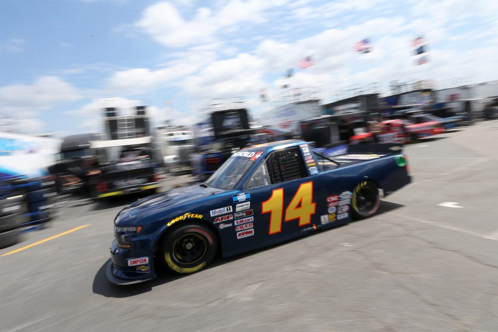 CONCORD, NORTH CAROLINA - MAY 28: Trey Hutchens III, driver of the #14 Heintz Bros. Performance Chevrolet, exits the garage area during practice for the NASCAR Camping World Truck Series North Carolina Education Lottery 200 at Charlotte Motor Speedway on May 28, 2021 in Concord, North Carolina. (Photo by Brian Lawdermilk/Getty Images) | Getty Images