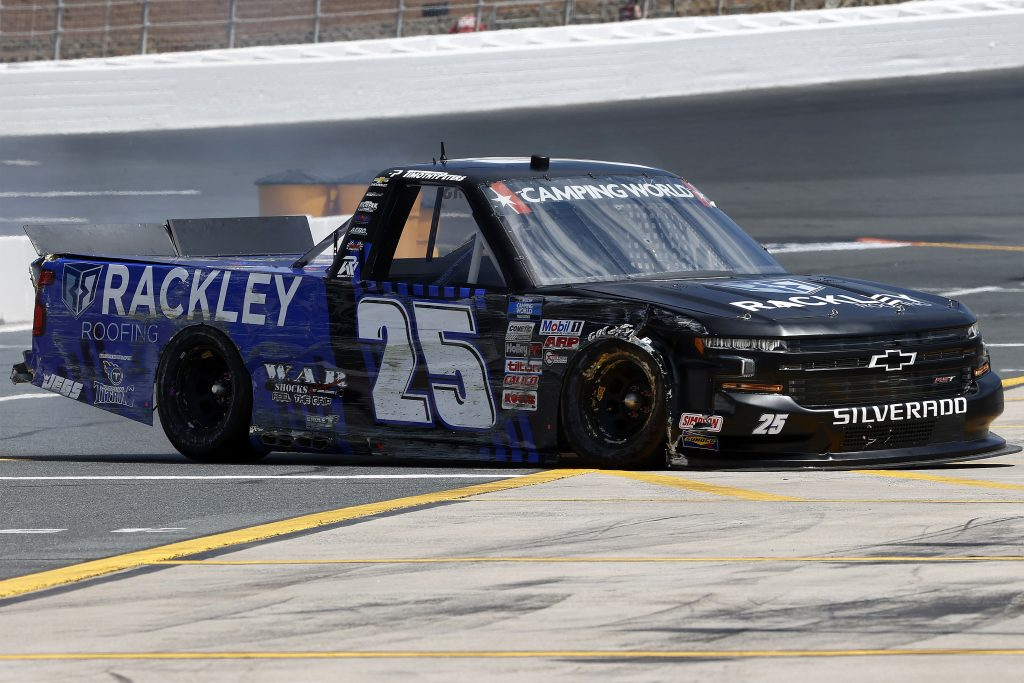 CONCORD, NORTH CAROLINA - MAY 28: Timothy Peters, driver of the #25 Rackley Roofing Chevrolet, damaged truck spins on the grid during practice for the NASCAR Camping World Truck Series North Carolina Education Lottery 200 at Charlotte Motor Speedway on May 28, 2021 in Concord, North Carolina. (Photo by Maddie Meyer/Getty Images) | Getty Images