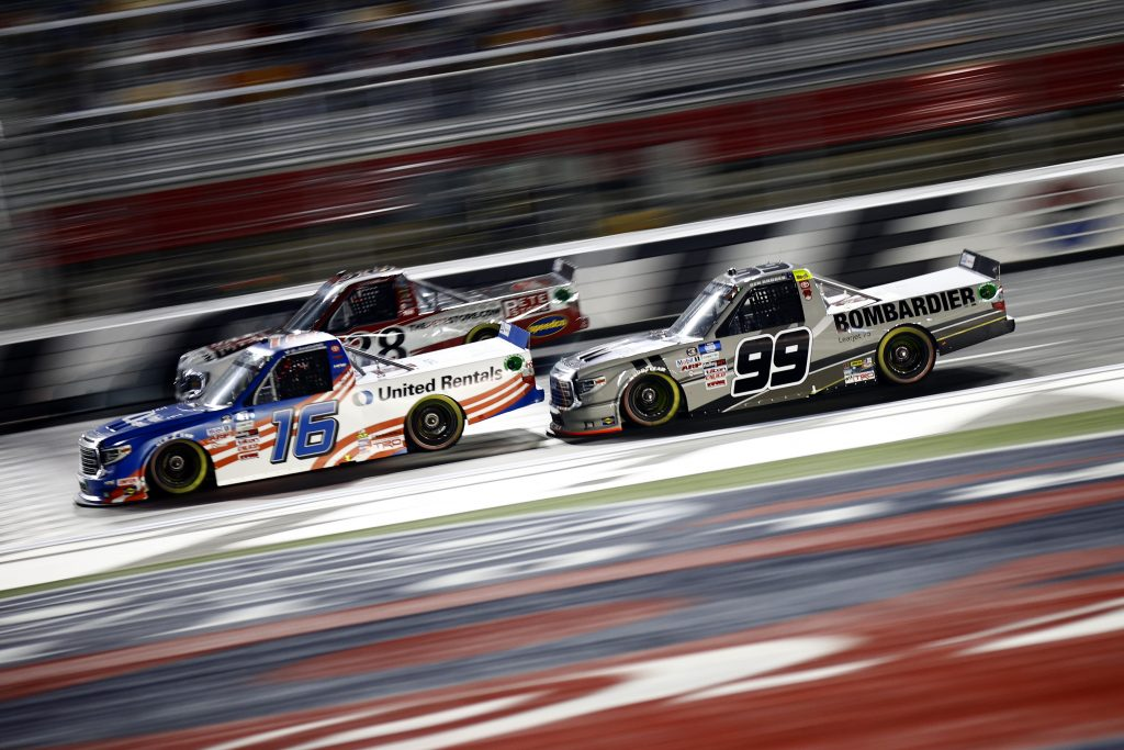 CONCORD, NORTH CAROLINA - MAY 28: Austin Hill, driver of the #16 United Rentals Toyota, Ben Rhodes, driver of the #99 Bombardier LearJet 75 Toyota, and Todd Gilliland, driver of the #38 The Pete Store Ford, race during the NASCAR Camping World Truck Series North Carolina Education Lottery 200 at Charlotte Motor Speedway on May 28, 2021 in Concord, North Carolina. (Photo by Jared C. Tilton/Getty Images) | Getty Images