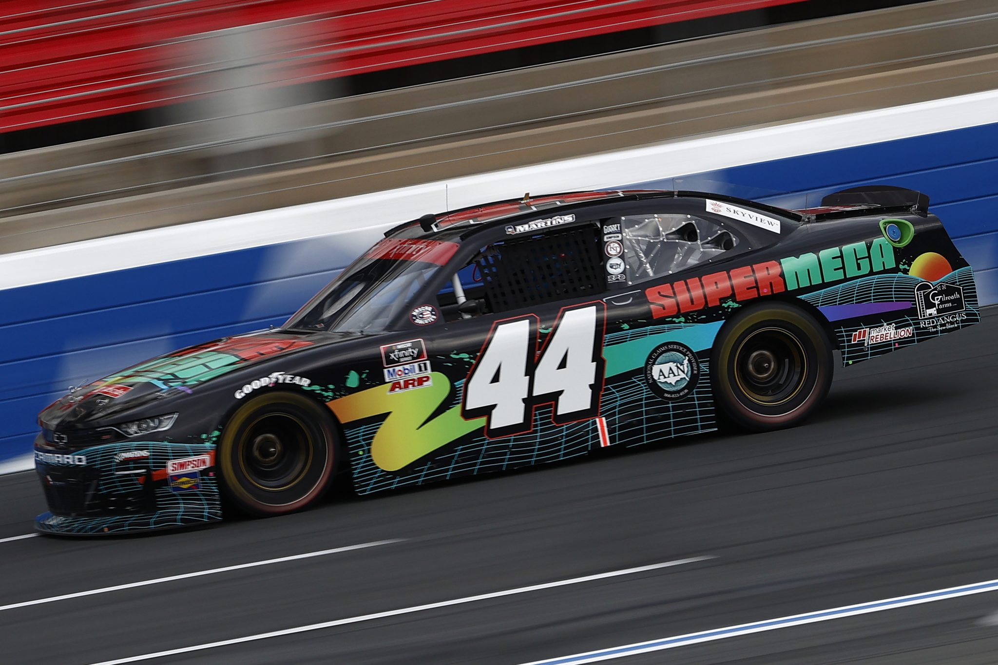 CONCORD, NORTH CAROLINA - MAY 28: Tommy Joe Martins, driver of the #44 Super Mega Chevrolet, drives during practice for the NASCAR Xfinity Series Alsco Uniforms 300 at Charlotte Motor Speedway on May 28, 2021 in Concord, North Carolina. (Photo by Maddie Meyer/Getty Images) | Getty Images