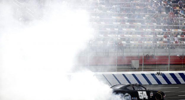 CONCORD, NORTH CAROLINA - MAY 29: Ty Gibbs, driver of the #54 Joe Gibbs Racing Toyota, celebrates with a burnout after winning the NASCAR Xfinity Series Alsco Uniforms 300 at Charlotte Motor Speedway on May 29, 2021 in Concord, North Carolina. (Photo by Jared C. Tilton/Getty Images) | Getty Images