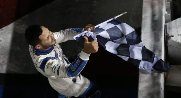 CONCORD, NORTH CAROLINA - MAY 30: Kyle Larson, driver of the #5 Metro Tech Chevrolet, gives a thumbs up to fans with the checkered flag after winning the NASCAR Cup Series Coca-Cola 600 at Charlotte Motor Speedway on May 30, 2021 in Concord, North Carolina. (Photo by Brian Lawdermilk/Getty Images)   Getty Images
