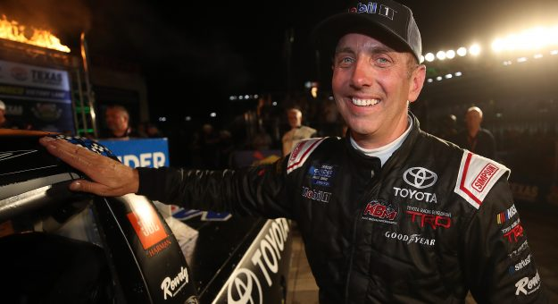 FORT WORTH, TEXAS - JUNE 07: Greg Biffle, driver of the #51 Toyota Toyota, celebrates in Victory Lane by putting the Winner's Sticker on his car after winning the NASCAR Gander Outdoors Truck Series SpeedyCash.com 400 at Texas Motor Speedway on June 07, 2019 in Fort Worth, Texas. (Photo by Chris Graythen/Getty Images) | Getty Images