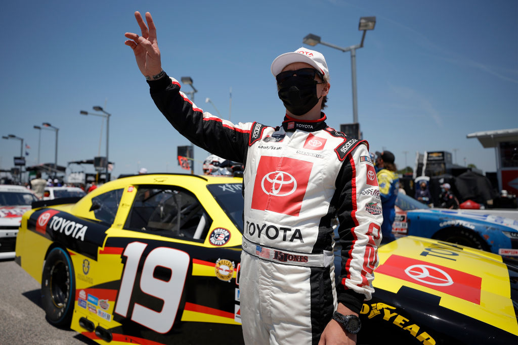 DARLINGTON, SOUTH CAROLINA - MAY 08: Brandon Jones, driver of the #19 06 NCWTS Championship Toyota, waves to fans on the grid prior to the NASCAR Xfinity Series Steakhouse Elite 200 at Darlington Raceway on May 08, 2021 in Darlington, South Carolina. (Photo by Chris Graythen/Getty Images) | Getty Images