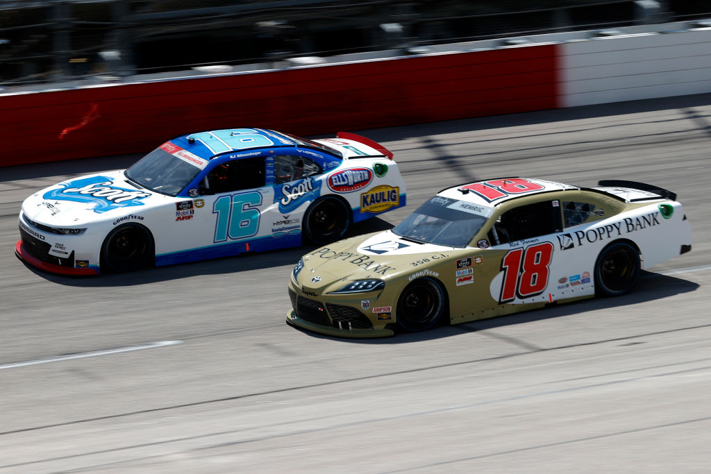 DARLINGTON, SOUTH CAROLINA - MAY 08: AJ Allmendinger, driver of the #16 Hyperice Chevrolet, and Daniel Hemric, driver of the #18 Poppy Bank Toyota, race during the NASCAR Xfinity Series Steakhouse Elite 200 at Darlington Raceway on May 08, 2021 in Darlington, South Carolina. (Photo by Chris Graythen/Getty Images) | Getty Images