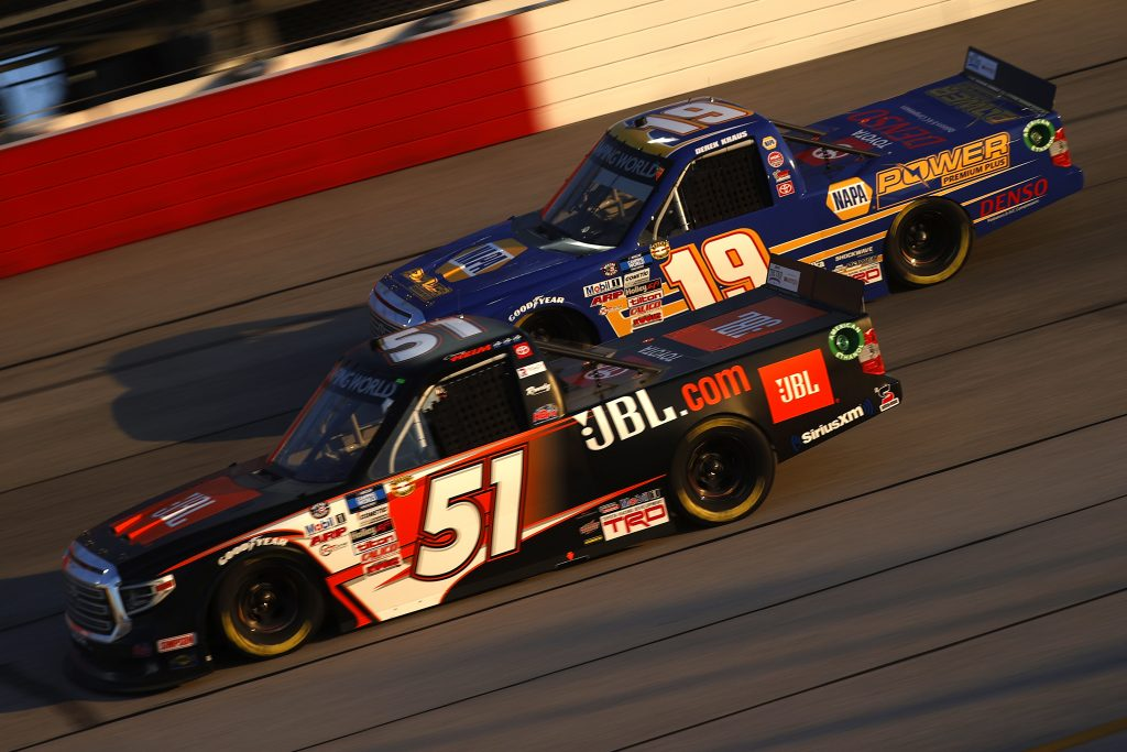 DARLINGTON, SOUTH CAROLINA - MAY 07: Corey Heim, driver of the #51 JBL Toyota, and Derek Kraus, driver of the #19 NAPA Power Premium Plus Toyota, race during the NASCAR Camping World Truck Series LiftKits4Less.com 200 at Darlington Raceway on May 07, 2021 in Darlington, South Carolina. (Photo by Chris Graythen/Getty Images) | Getty Images