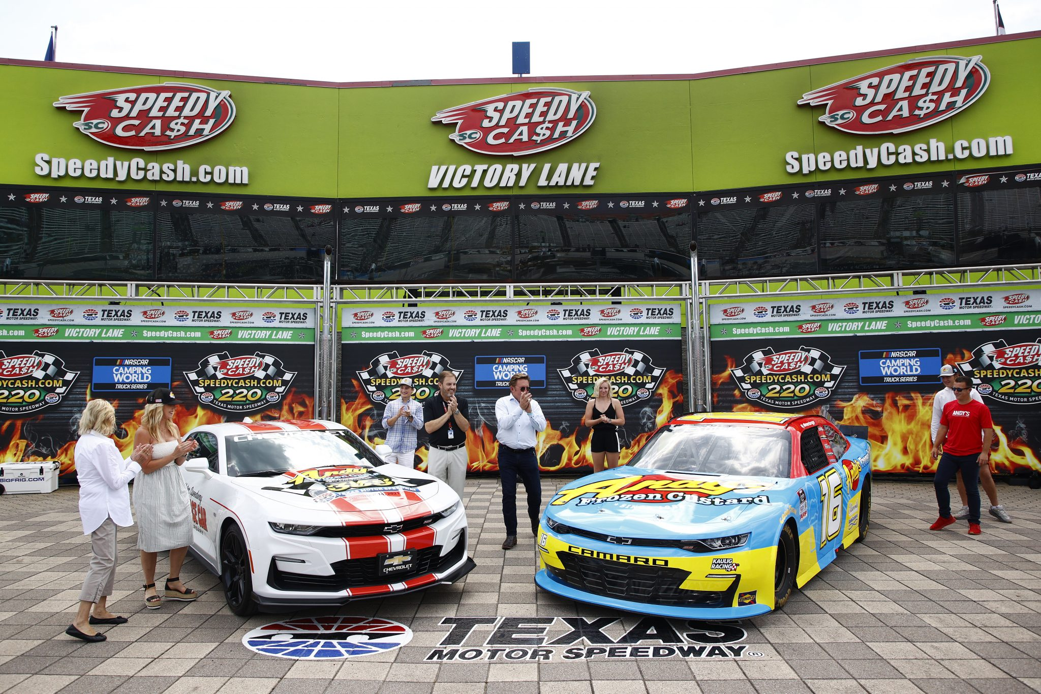 FORT WORTH, TEXAS - JUNE 12: (L-R) Andy Kuntz, CEO & owner of Andy's Frozen Custard Texas Motor Speedway President Eddie Gossage and Xfinity driver A. J. Allmendinger pose for photos after unveiling the paint scheme for the the #16 Andy's Frozen Custard Chevrolet prior to the NASCAR Xfinity Series Alsco Uniforms 250 at Texas Motor Speedway on June 12, 2021 in Fort Worth, Texas. (Photo by Jared C. Tilton/Getty Images) | Getty Images
