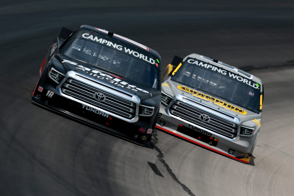 FORT WORTH, TEXAS - JUNE 12: Chandler Smith, driver of the #18 Safelite AutoGlass Toyota, and Grant Enfinger, driver of the #98 Champion/Curb Records Toyota, race during the NASCAR Camping World Truck Series SpeedyCash.com 220 at Texas Motor Speedway on June 12, 2021 in Fort Worth, Texas. (Photo by Sean Gardner/Getty Images) | Getty Images