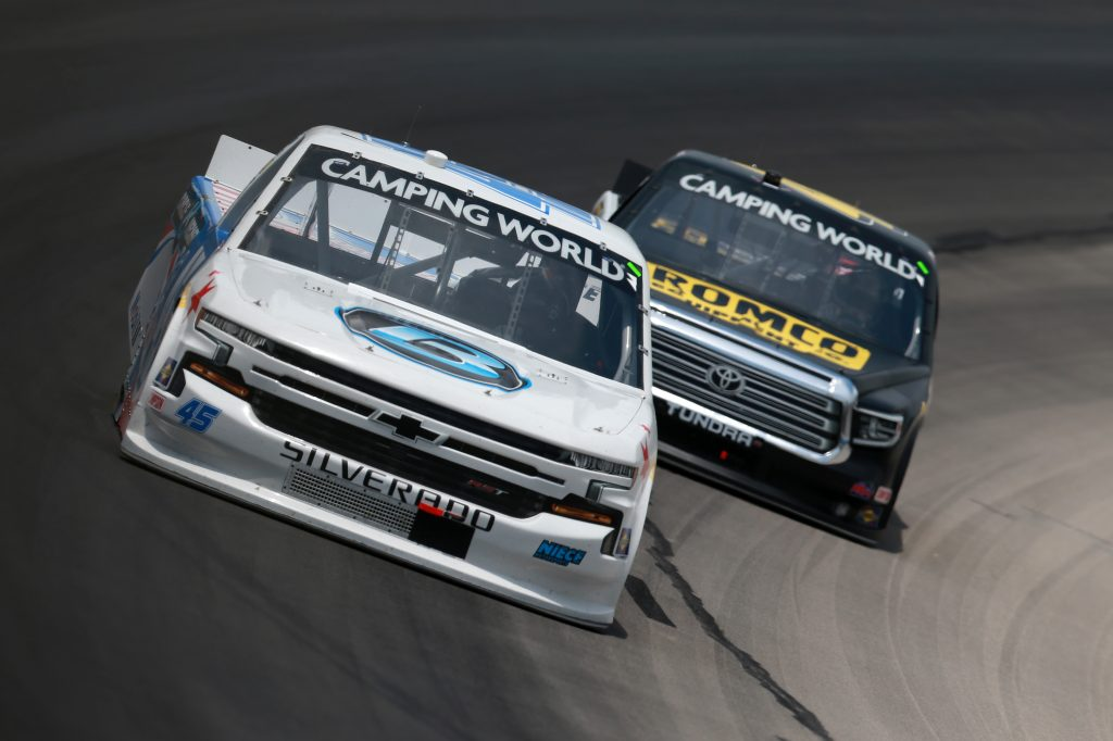 FORT WORTH, TEXAS - JUNE 12: Ross Chastain, driver of the #45 Circle B Diecast Chevrolet, and John Hunter Nemechek, driver of the #4 ROMCO Toyota, race during the NASCAR Camping World Truck Series SpeedyCash.com 220 at Texas Motor Speedway on June 12, 2021 in Fort Worth, Texas. (Photo by Sean Gardner/Getty Images)   Getty Images