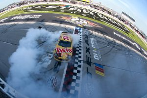 FORT WORTH, TEXAS - JUNE 12: Kyle Busch, driver of the #54 Twix Toyota, celebrates with a burnout after winning the NASCAR Xfinity Series Alsco Uniforms 250 at Texas Motor Speedway on June 12, 2021 in Fort Worth, Texas. (Photo by Sean Gardner/Getty Images) | Getty Images