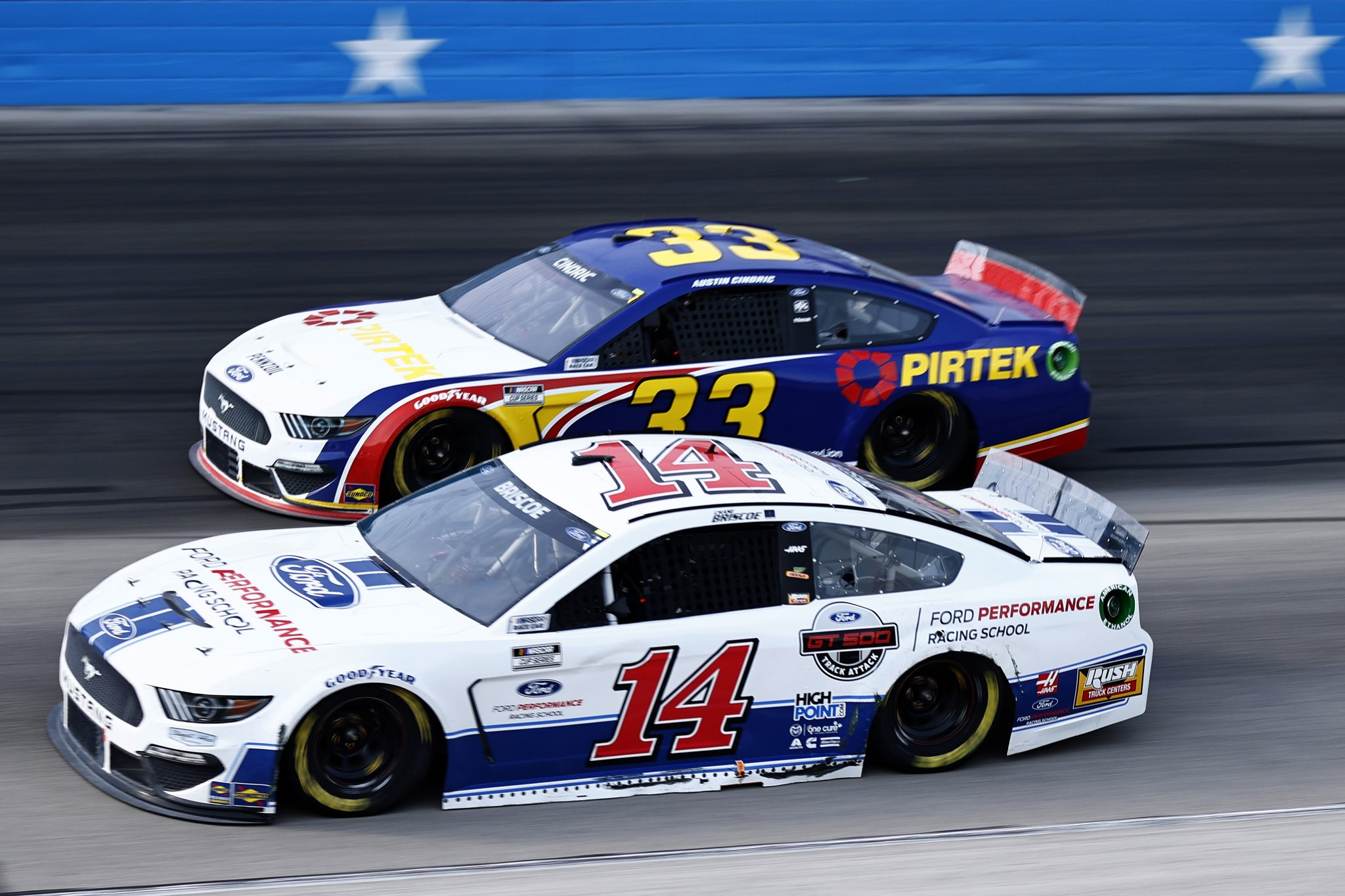 FORT WORTH, TEXAS - JUNE 13: Chase Briscoe, driver of the #14 Ford Performance Racing School Ford, and Austin Cindric, driver of the #33 Pirtek Ford, race during the NASCAR All-Star Open at Texas Motor Speedway on June 13, 2021 in Fort Worth, Texas. (Photo by Jared C. Tilton/Getty Images)   Getty Images