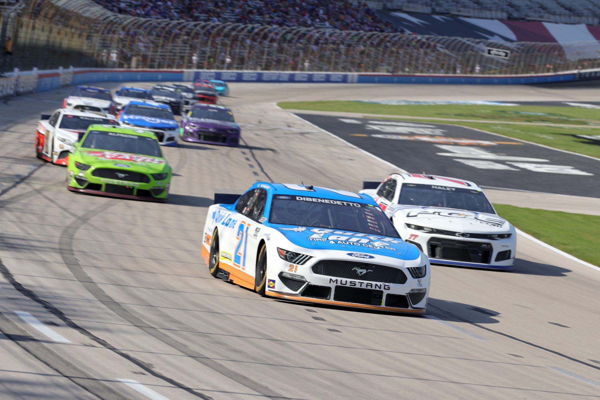 FORT WORTH, TEXAS - JUNE 13: Matt DiBenedetto, driver of the #21 Quick Lane Tire & Auto Center Ford, leads the field during the NASCAR All-Star Open at Texas Motor Speedway on June 13, 2021 in Fort Worth, Texas. (Photo by Carmen Mandato/Getty Images)   Getty Images