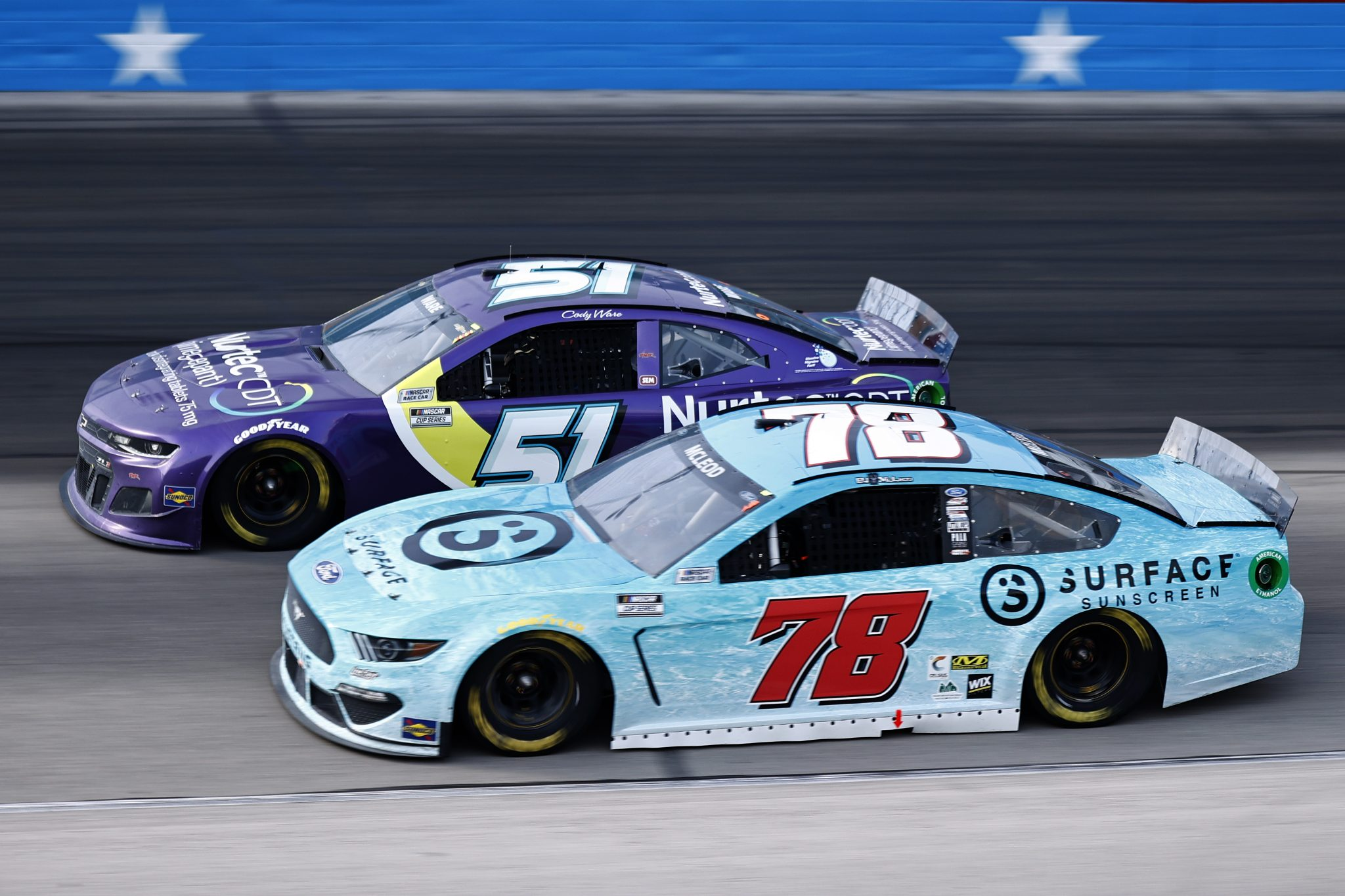 FORT WORTH, TEXAS - JUNE 13: BJ McLeod, driver of the #78 Surface Sunscreen Ford, and Cody Ware, driver of the #51 Petty Ware Racing Chevrolet, race during the NASCAR All-Star Open at Texas Motor Speedway on June 13, 2021 in Fort Worth, Texas. (Photo by Jared C. Tilton/Getty Images)   Getty Images