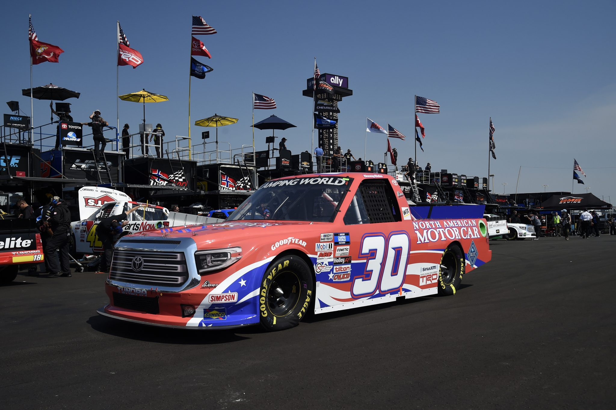 LEBANON, TENNESSEE - JUNE 18: Danny Bohn, driver of the #30 North American Motor Car Toyota, drives in the garage area during practice for the NASCAR Camping World Truck Series Rackley Roofing 200 at Nashville Superspeedway on June 18, 2021 in Lebanon, Tennessee. (Photo by Logan Riely/Getty Images) | Getty Images