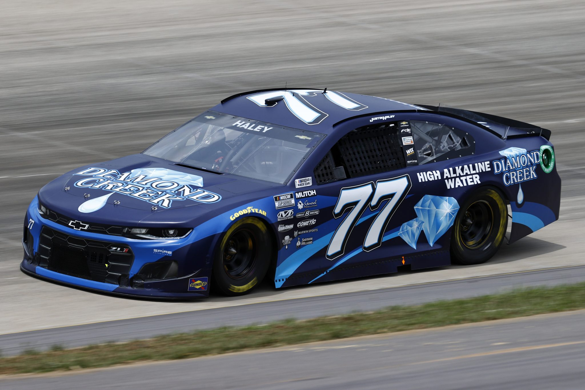 LEBANON, TENNESSEE - JUNE 19: Justin Haley, driver of the #77 Diamond Creek Water Chevrolet, drives during practice for the NASCAR Cup Series Ally 400 at Nashville Superspeedway on June 19, 2021 in Lebanon, Tennessee. (Photo by Jared C. Tilton/Getty Images) | Getty Images