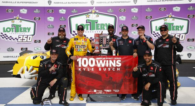LEBANON, TENNESSEE - JUNE 19: Kyle Busch, driver of the #54 M&M's Toyota, and crew celebrate Kyle's 100th win in victory lane after winning the NASCAR Xfinity Series Tennessee Lottery 250 at Nashville Superspeedway on June 19, 2021 in Lebanon, Tennessee. (Photo by Jared C. Tilton/Getty Images) | Getty Images