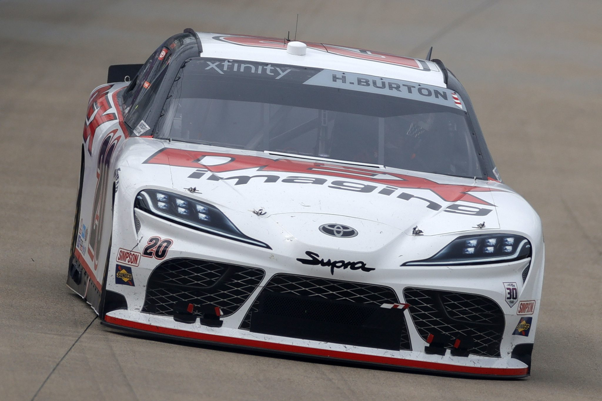 LEBANON, TENNESSEE - JUNE 19: Harrison Burton, driver of the #20 DEX Imaging Toyota, drives during the NASCAR Xfinity Series Tennessee Lottery 250 at Nashville Superspeedway on June 19, 2021 in Lebanon, Tennessee. (Photo by Sarah Stier/Getty Images) | Getty Images