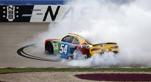 LEBANON, TENNESSEE - JUNE 19: Kyle Busch, driver of the #54 M&M's Toyota, celebrates with a burnout after winning the NASCAR Xfinity Series Tennessee Lottery 250 at Nashville Superspeedway on June 19, 2021 in Lebanon, Tennessee. (Photo by Jared C. Tilton/Getty Images)   Getty Images