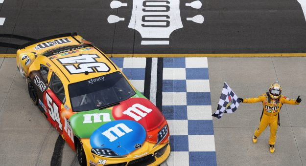 LEBANON, TENNESSEE - JUNE 19: Kyle Busch, driver of the #54 M&M's Toyota, celebrates with the checkered flag after winning the NASCAR Xfinity Series Tennessee Lottery 250 at Nashville Superspeedway on June 19, 2021 in Lebanon, Tennessee. (Photo by Sarah Stier/Getty Images)   Getty Images