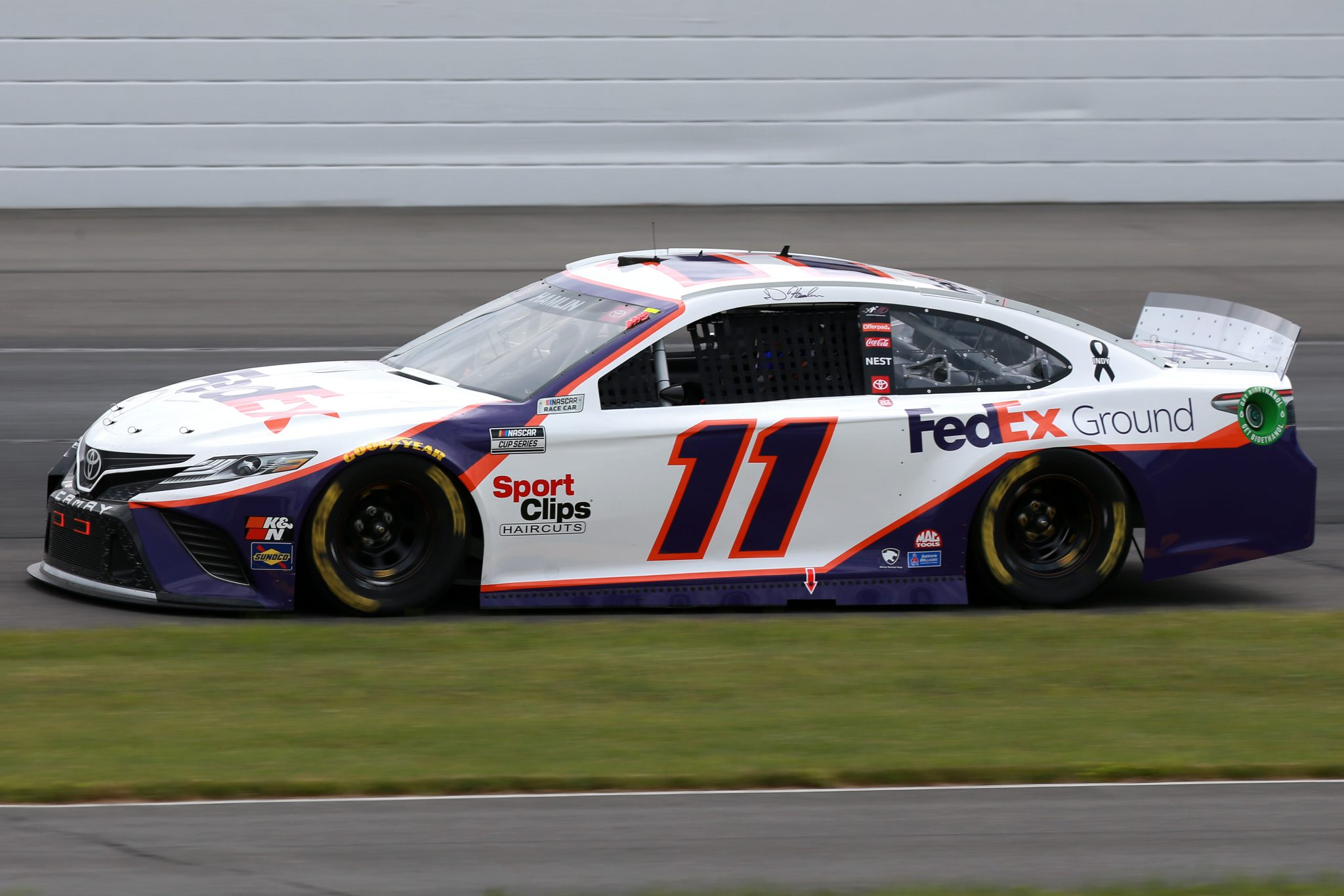 LONG POND, PENNSYLVANIA - JUNE 26: Denny Hamlin, driver of the #11 FedEx Ground Toyota, drives during the NASCAR Cup Series Pocono Organics CBD 325 at Pocono Raceway on June 26, 2021 in Long Pond, Pennsylvania. (Photo by Sean Gardner/Getty Images)   Getty Images