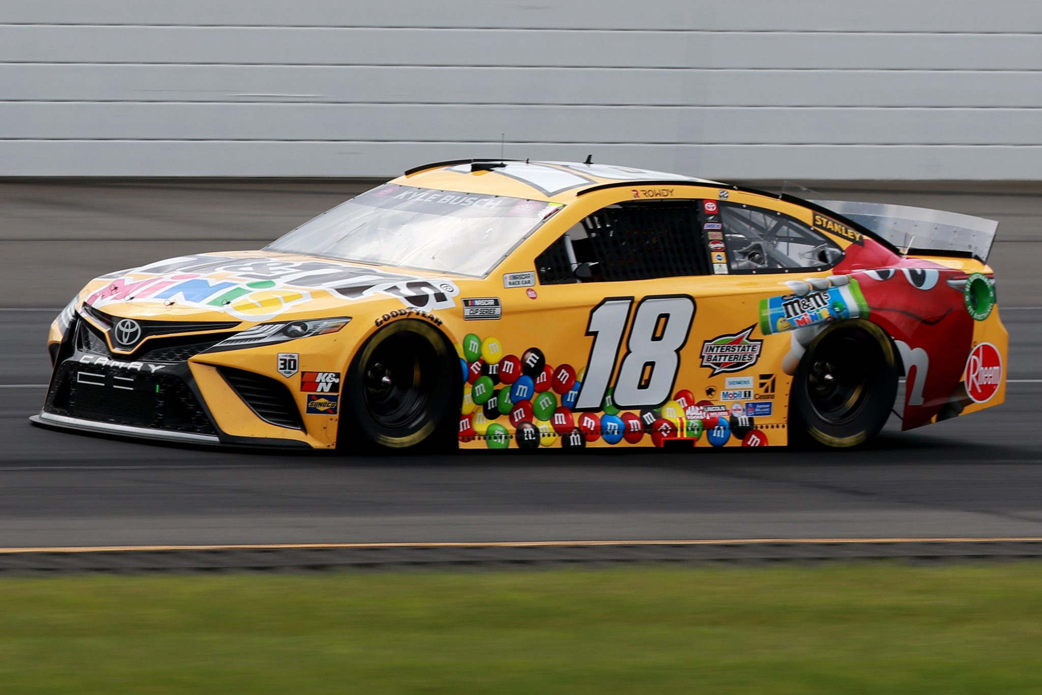 LONG POND, PENNSYLVANIA - JUNE 26: Kyle Busch, driver of the #18 M&M's Mini's Toyota, drives during the NASCAR Cup Series Pocono Organics CBD 325 at Pocono Raceway on June 26, 2021 in Long Pond, Pennsylvania. (Photo by Sean Gardner/Getty Images) | Getty Images