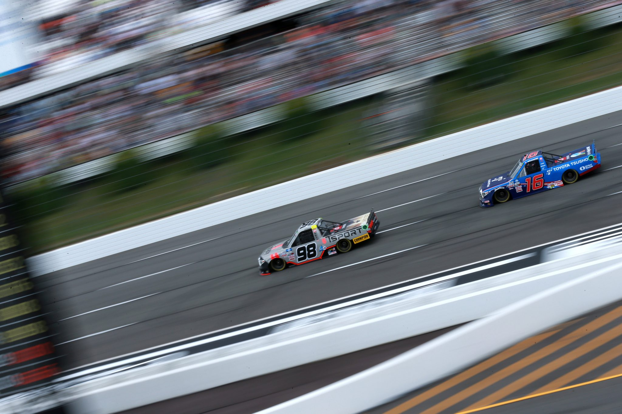 LONG POND, PENNSYLVANIA - JUNE 26: Christian Eckes, driver of the #98 Toyota, and Austin Hill, driver of the #16 Toyota Tsusho Toyota, race during the NASCAR Camping World Truck Series CRC Brakleen 150 at Pocono Raceway on June 26, 2021 in Long Pond, Pennsylvania. (Photo by Sean Gardner/Getty Images) | Getty Images