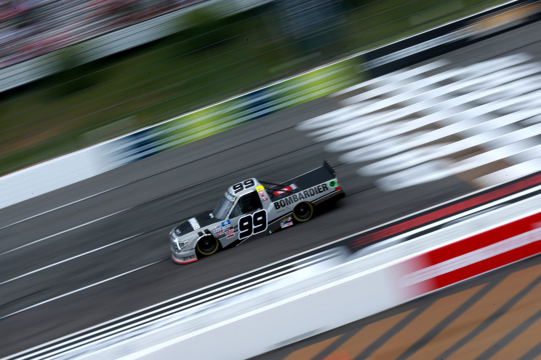 LONG POND, PENNSYLVANIA - JUNE 26: Ben Rhodes, driver of the #99 Toyota, drives during the NASCAR Camping World Truck Series CRC Brakleen 150 at Pocono Raceway on June 26, 2021 in Long Pond, Pennsylvania. (Photo by Sean Gardner/Getty Images) | Getty Images