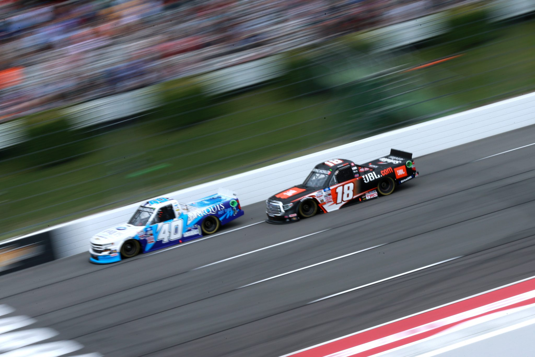 LONG POND, PENNSYLVANIA - JUNE 26: Ryan Truex, driver of the #40 Marquis Spas Chevrolet, and Chandler Smith, driver of the #18 JBL Toyota, race during the NASCAR Camping World Truck Series CRC Brakleen 150 at Pocono Raceway on June 26, 2021 in Long Pond, Pennsylvania. (Photo by Sean Gardner/Getty Images) | Getty Images
