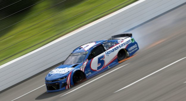 LONG POND, PENNSYLVANIA - JUNE 26: Kyle Larson, driver of the #5 HendrickCars.com Chevrolet, drives with a flat tire on the final turn of the NASCAR Cup Series Pocono Organics CBD 325 at Pocono Raceway on June 26, 2021 in Long Pond, Pennsylvania. (Photo by James Gilbert/Getty Images) | Getty Images