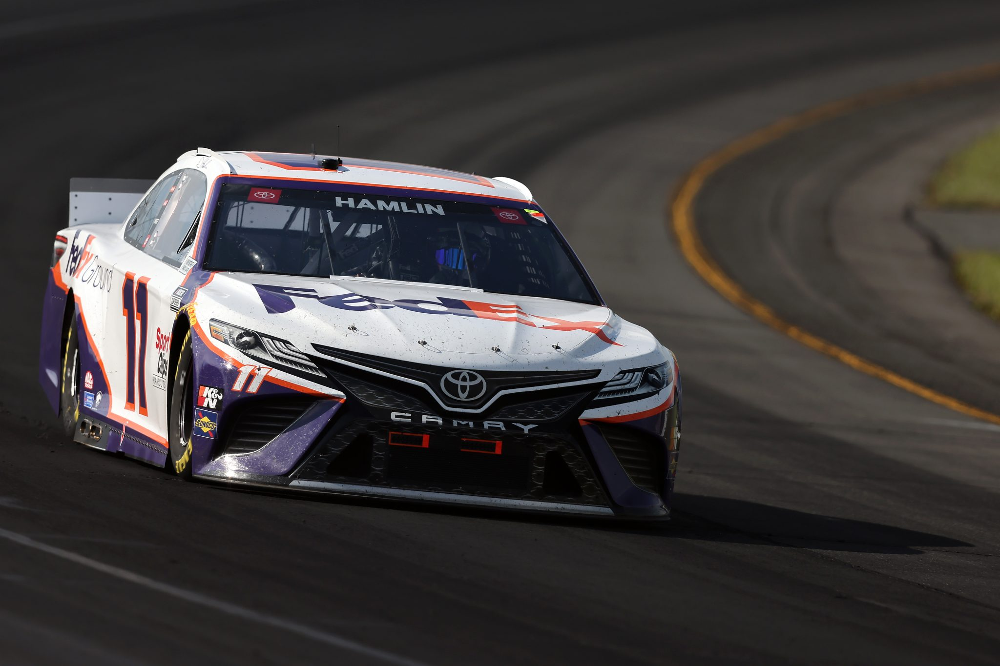 LONG POND, PENNSYLVANIA - JUNE 27: Denny Hamlin, driver of the #11 FedEx Ground Toyota, drives during the NASCAR Cup Series Explore the Pocono Mountains 350 at Pocono Raceway on June 27, 2021 in Long Pond, Pennsylvania. (Photo by James Gilbert/Getty Images) | Getty Images