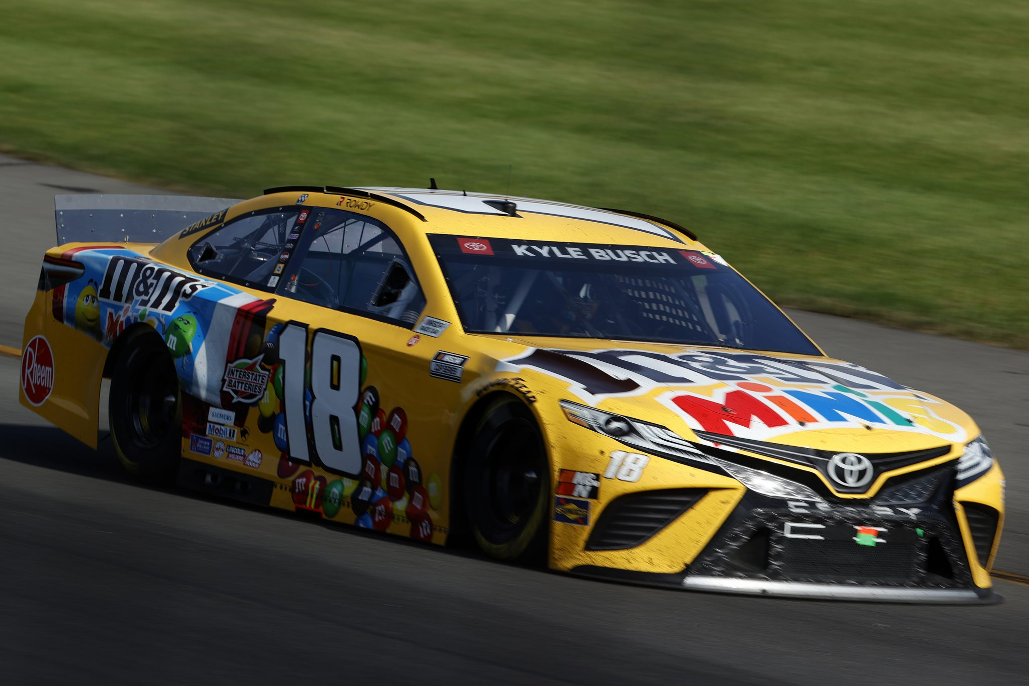 LONG POND, PENNSYLVANIA - JUNE 27: Kyle Busch, driver of the #18 M&M's Mini's Toyota, drives during the NASCAR Cup Series Explore the Pocono Mountains 350 at Pocono Raceway on June 27, 2021 in Long Pond, Pennsylvania. (Photo by Tim Nwachukwu/Getty Images) | Getty Images