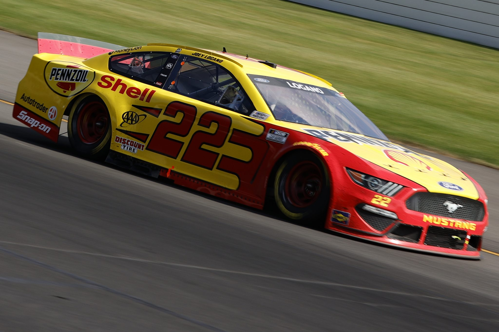 LONG POND, PENNSYLVANIA - JUNE 27: Joey Logano, driver of the #22 Shell Pennzoil Ford, drives during the NASCAR Cup Series Explore the Pocono Mountains 350 at Pocono Raceway on June 27, 2021 in Long Pond, Pennsylvania. (Photo by Tim Nwachukwu/Getty Images) | Getty Images