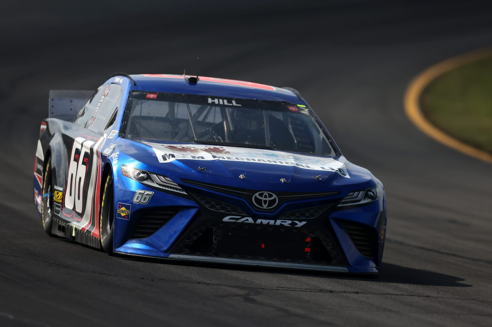 LONG POND, PENNSYLVANIA - JUNE 27: Timmy Hill, driver of the #66 M&M Mechanical Toyota, drives during the NASCAR Cup Series Explore the Pocono Mountains 350 at Pocono Raceway on June 27, 2021 in Long Pond, Pennsylvania. (Photo by James Gilbert/Getty Images) | Getty Images