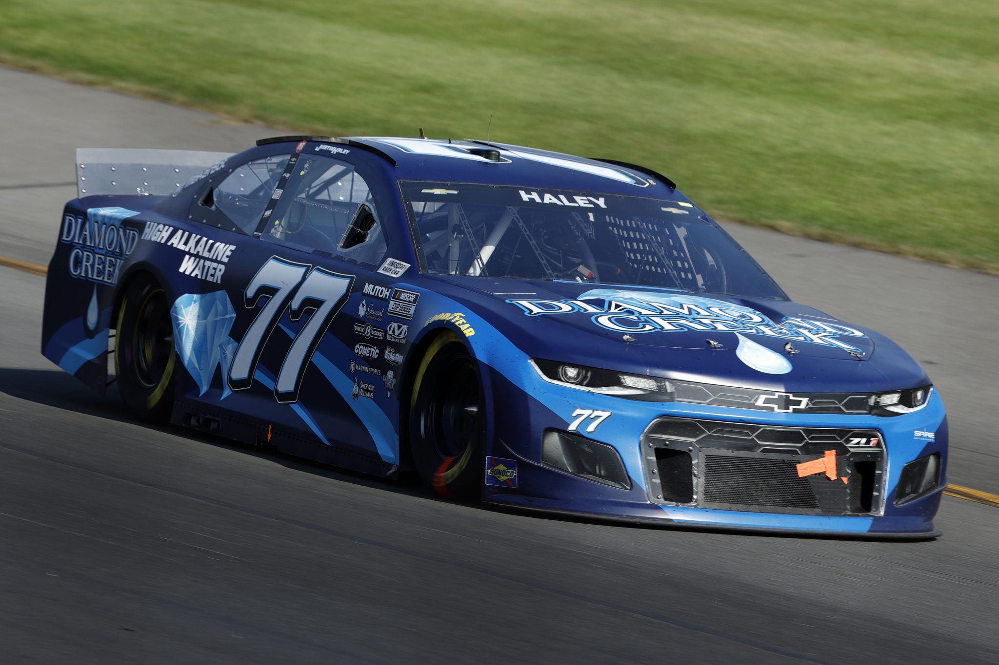 LONG POND, PENNSYLVANIA - JUNE 27: Justin Allgaier, driver of the #77 Diamond Creek Water Chevrolet, drives, replacing Justin Haley during the NASCAR Cup Series Explore the Pocono Mountains 350 at Pocono Raceway on June 27, 2021 in Long Pond, Pennsylvania. (Photo by Tim Nwachukwu/Getty Images) | Getty Images