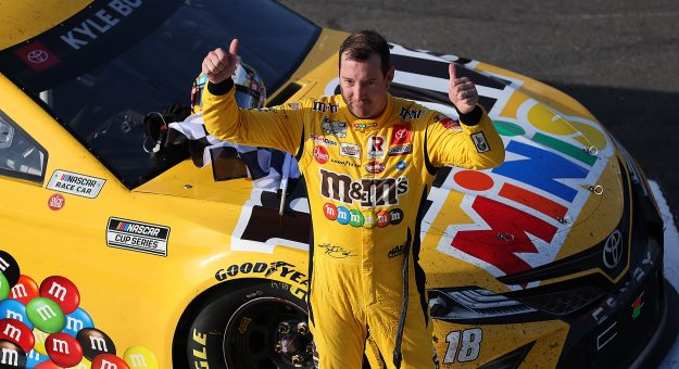 LONG POND, PENNSYLVANIA - JUNE 27: Kyle Busch, driver of the #18 M&M's Mini's Toyota, gives fans a thumbs up after winning the NASCAR Xfinity Series Pocono Green 225 Recycled by J.P. Mascaro & Sons at Pocono Raceway on June 27, 2021 in Long Pond, Pennsylvania. (Photo by James Gilbert/Getty Images) | Getty Images