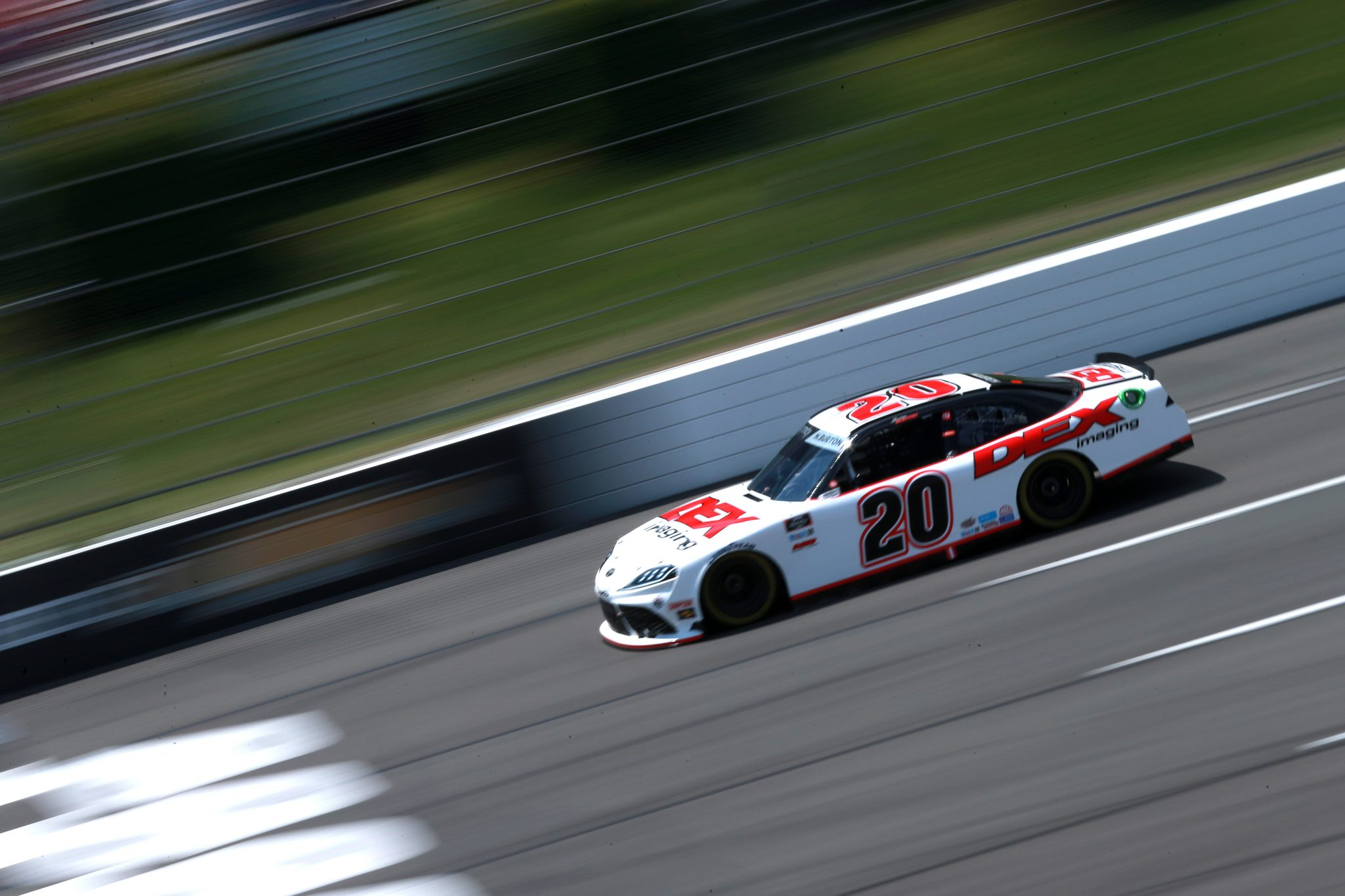 LONG POND, PENNSYLVANIA - JUNE 27: Harrison Burton, driver of the #20 DEX Imaging Toyota, drives during the NASCAR Xfinity Series Pocono Green 225 Recycled by J.P. Mascaro & Sons at Pocono Raceway on June 27, 2021 in Long Pond, Pennsylvania. (Photo by Sean Gardner/Getty Images) | Getty Images