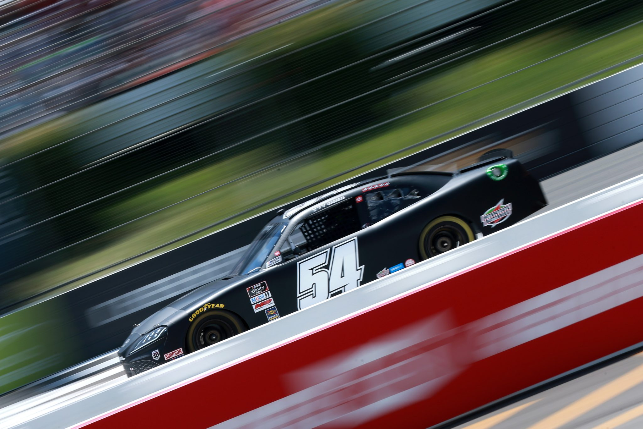 LONG POND, PENNSYLVANIA - JUNE 27: Ty Gibbs, driver of the #54 Joe Gibbs Racing Toyota, drives during the NASCAR Xfinity Series Pocono Green 225 Recycled by J.P. Mascaro & Sons at Pocono Raceway on June 27, 2021 in Long Pond, Pennsylvania. (Photo by Sean Gardner/Getty Images) | Getty Images