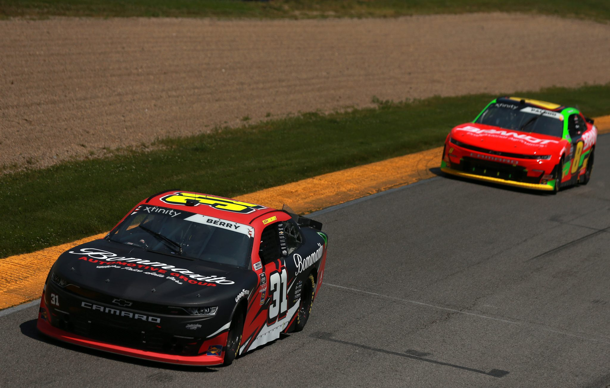 LEXINGTON, OHIO - JUNE 05: Josh Berry, driver of the #31 Bommarito Automotive Group Chevrolet, and Miguel Paludo, driver of the #8 BRANDT Chevrolet, race during the NASCAR Xfinity Series B&L Transport 170 at Mid-Ohio Sports Car Course on June 05, 2021 in Lexington, Ohio. (Photo by Sean Gardner/Getty Images) | Getty Images