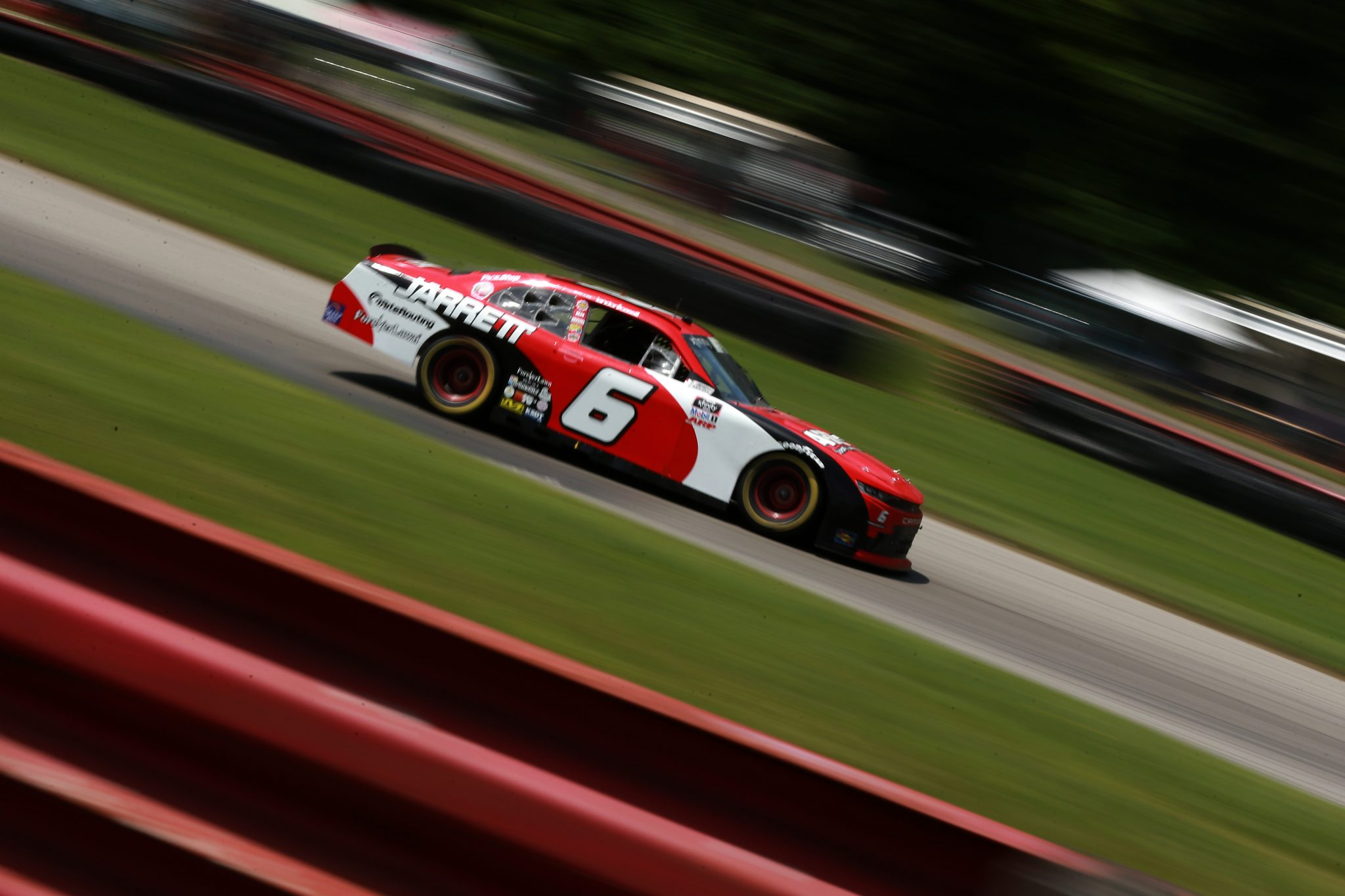 LEXINGTON, OHIO - JUNE 05: Landon Cassill, driver of the #6 Jarrett Logistics Chevrolet, drives during the NASCAR Xfinity Series B&L Transport 170 at Mid-Ohio Sports Car Course on June 05, 2021 in Lexington, Ohio. (Photo by Sean Gardner/Getty Images) | Getty Images