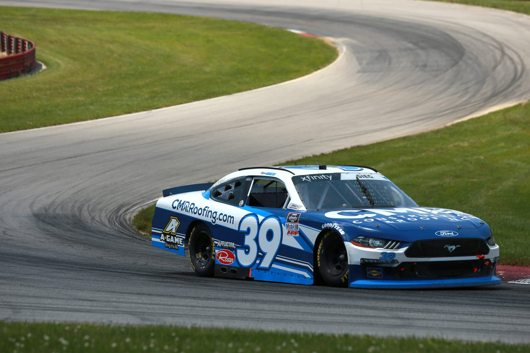 LEXINGTON, OHIO - JUNE 05: Ryan Sieg, driver of the #39 CMR Construction and Roofing/A-Game Ford, drives during the NASCAR Xfinity Series B&L Transport 170 at Mid-Ohio Sports Car Course on June 05, 2021 in Lexington, Ohio. (Photo by Sean Gardner/Getty Images) | Getty Images