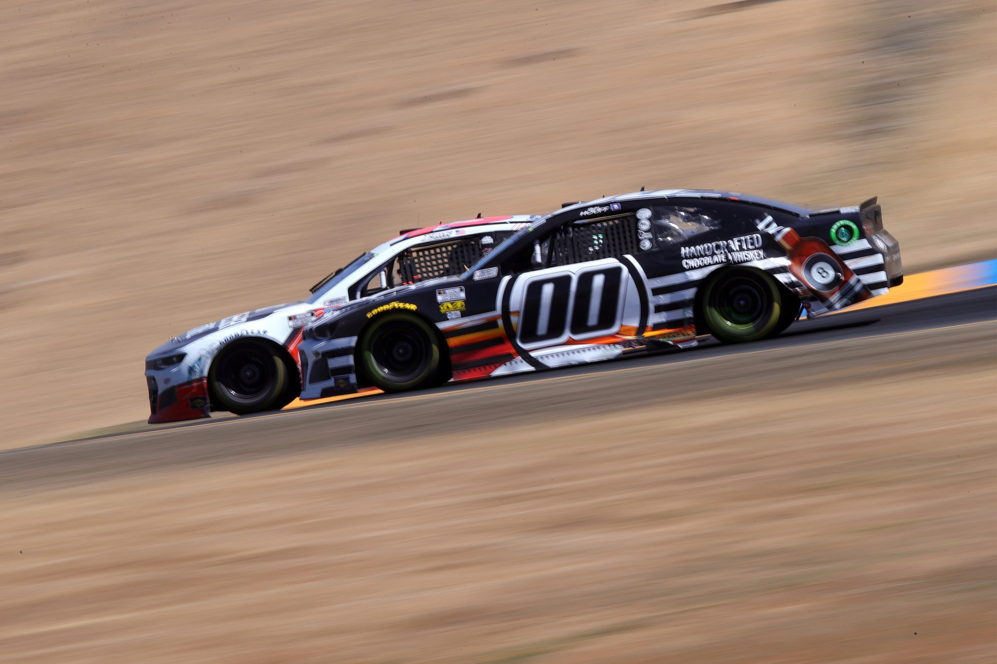 SONOMA, CALIFORNIA - JUNE 06: Quin Houff, driver of the #00 8 Ball Chocolate Whiskey Chevrolet, drives during the NASCAR Cup Series Toyota/Save Mart 350 at Sonoma Raceway on June 06, 2021 in Sonoma, California. (Photo by Carmen Mandato/Getty Images) | Getty Images
