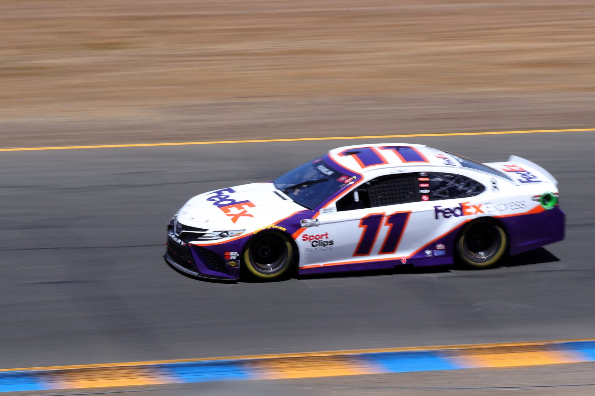 SONOMA, CALIFORNIA - JUNE 06: Denny Hamlin, driver of the #11 FedEx Express Toyota, drives during the NASCAR Cup Series Toyota/Save Mart 350 at Sonoma Raceway on June 06, 2021 in Sonoma, California. (Photo by Carmen Mandato/Getty Images) | Getty Images