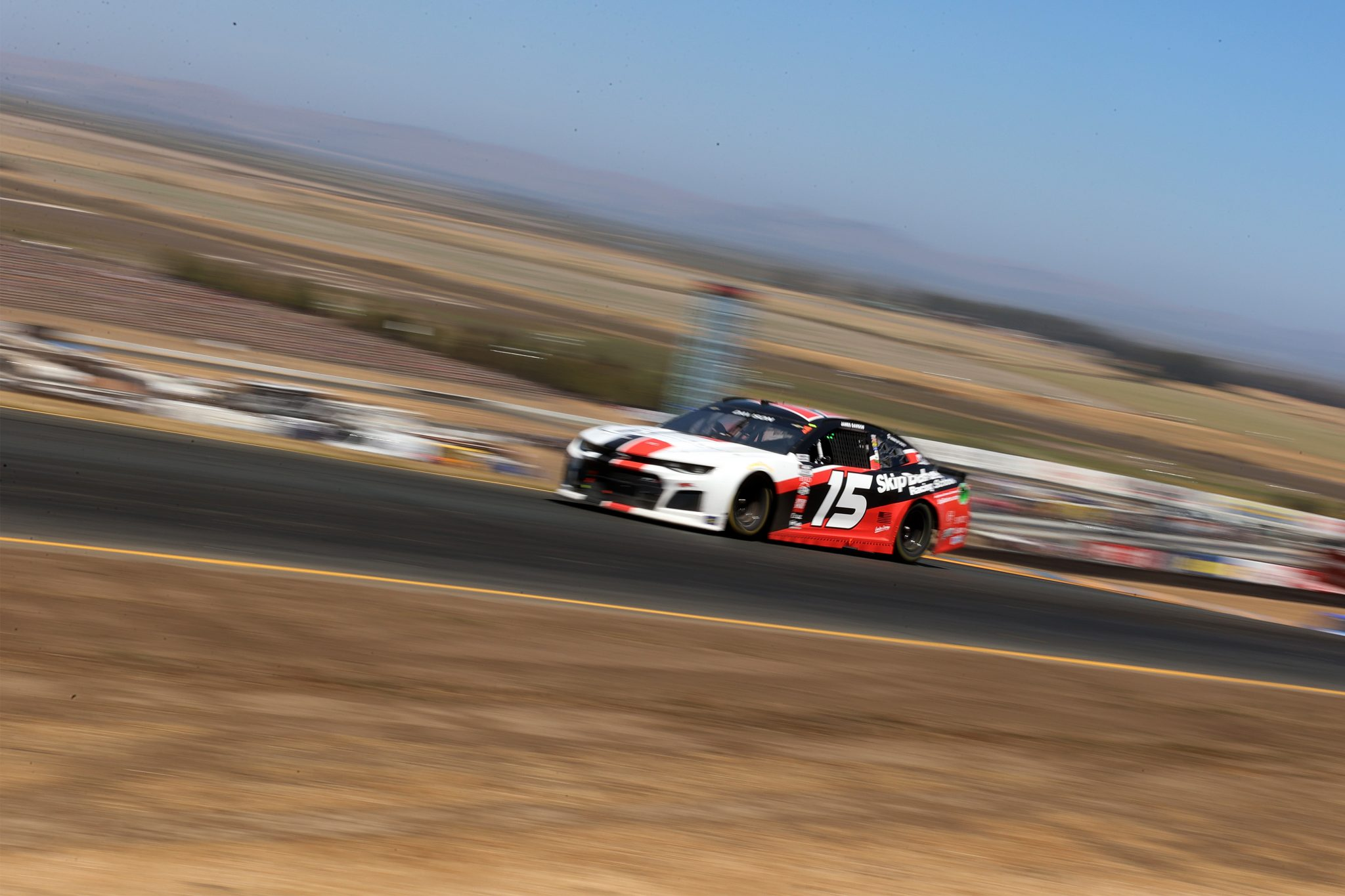SONOMA, CALIFORNIA - JUNE 06: James Davison, driver of the #15 Clubhouse Media Group Chevrolet, drives during the NASCAR Cup Series Toyota/Save Mart 350 at Sonoma Raceway on June 06, 2021 in Sonoma, California. (Photo by Carmen Mandato/Getty Images) | Getty Images