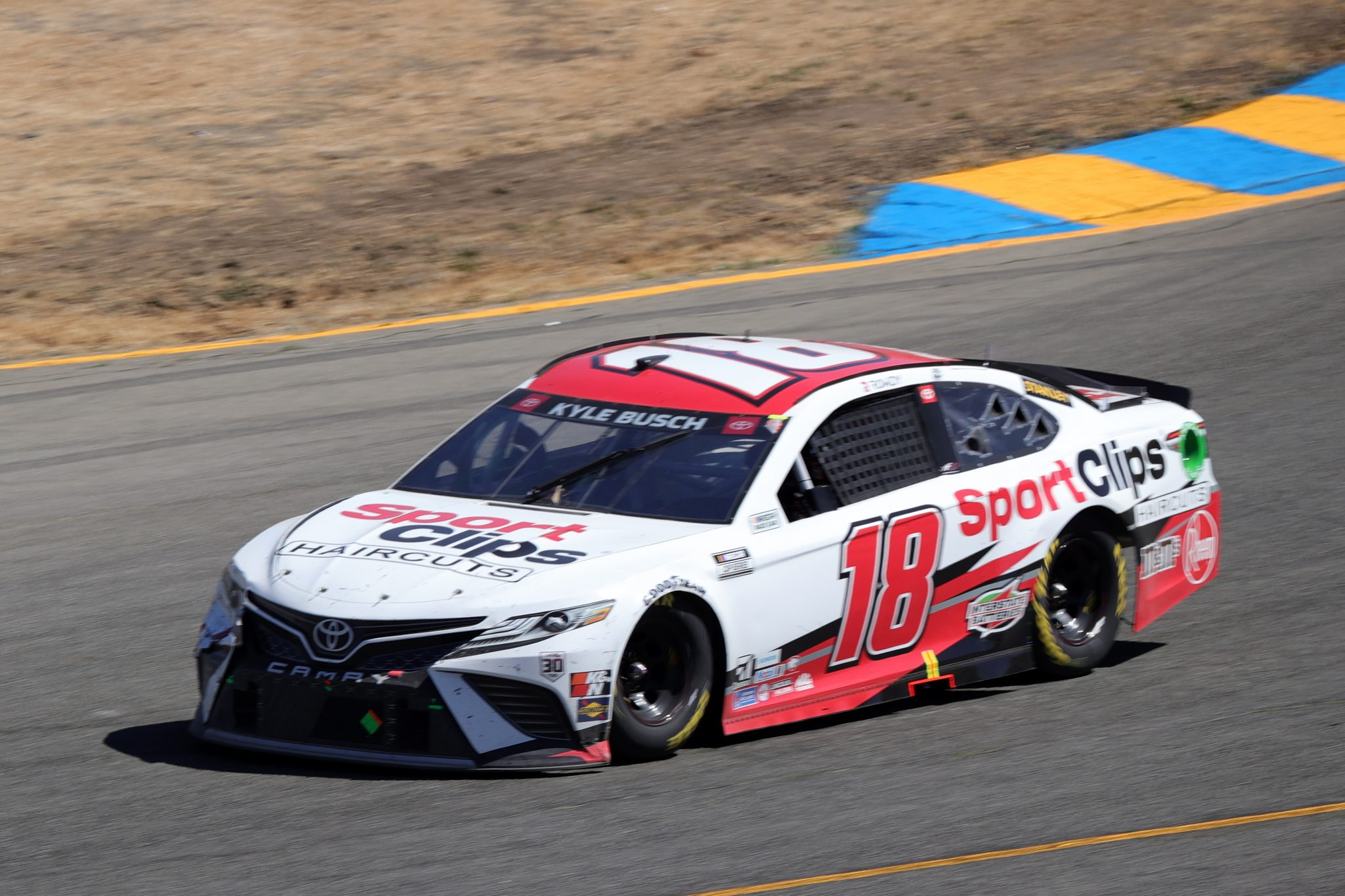 SONOMA, CALIFORNIA - JUNE 06: Kyle Busch, driver of the #18 Sport Clips Toyota, drives during the NASCAR Cup Series Toyota/Save Mart 350 at Sonoma Raceway on June 06, 2021 in Sonoma, California. (Photo by Carmen Mandato/Getty Images) | Getty Images
