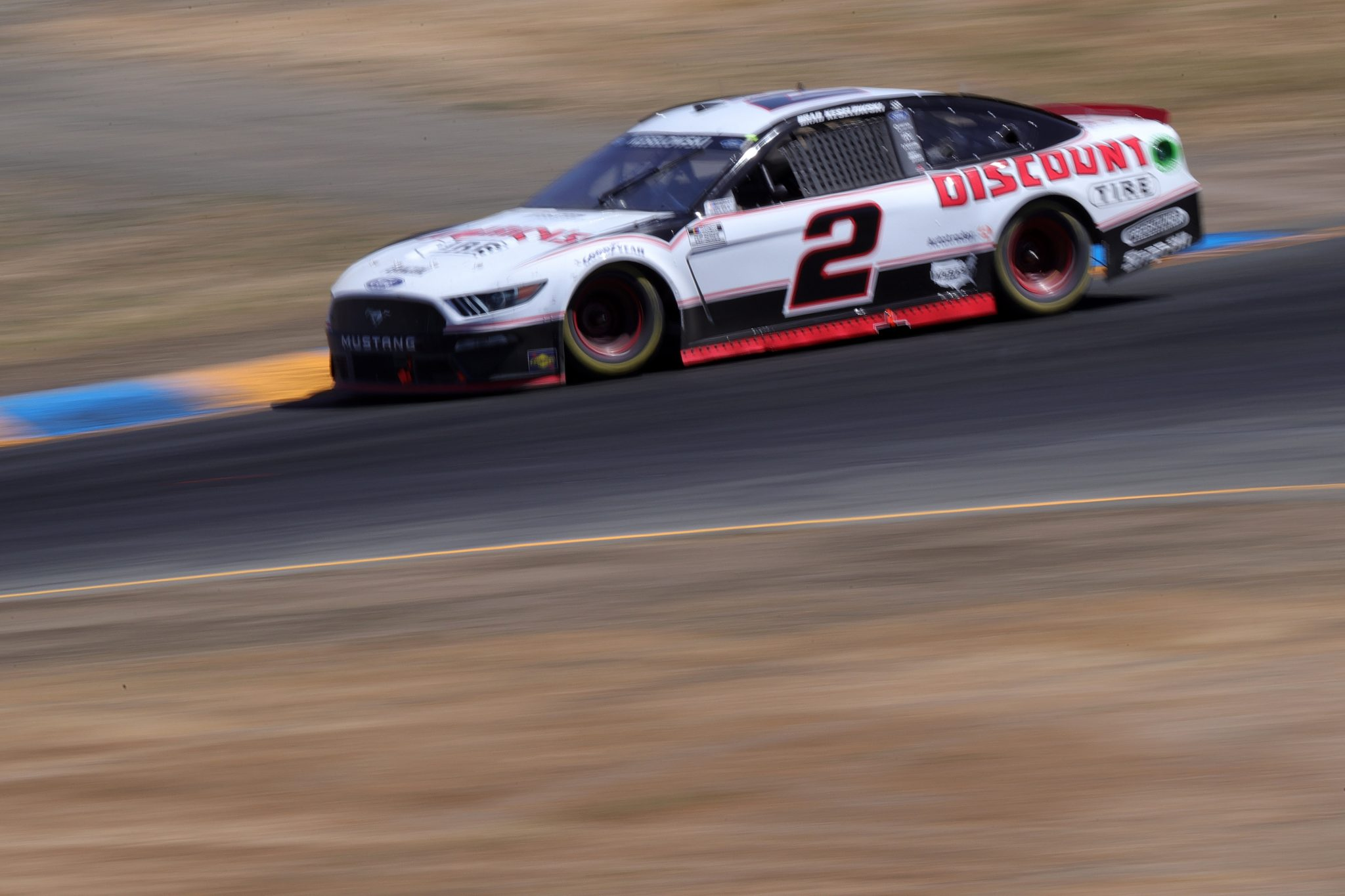 SONOMA, CALIFORNIA - JUNE 06: Brad Keselowski, driver of the #2 America's Tire Ford, drives during the NASCAR Cup Series Toyota/Save Mart 350 at Sonoma Raceway on June 06, 2021 in Sonoma, California. (Photo by Carmen Mandato/Getty Images) | Getty Images