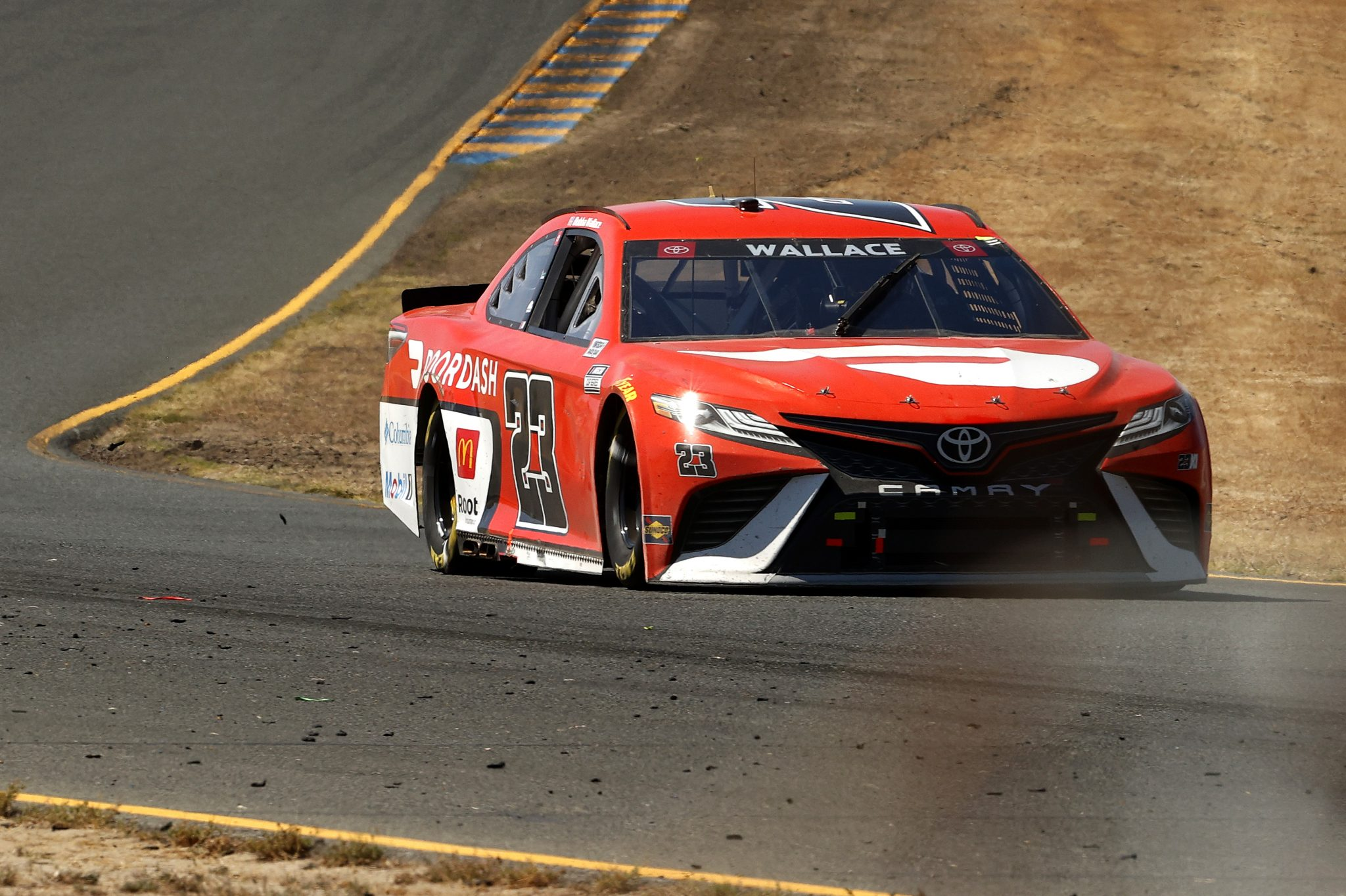 SONOMA, CALIFORNIA - JUNE 06: Bubba Wallace, driver of the #23 DoorDash Toyota, drives during the NASCAR Cup Series Toyota/Save Mart 350 at Sonoma Raceway on June 06, 2021 in Sonoma, California. (Photo by Maddie Meyer/Getty Images) | Getty Images