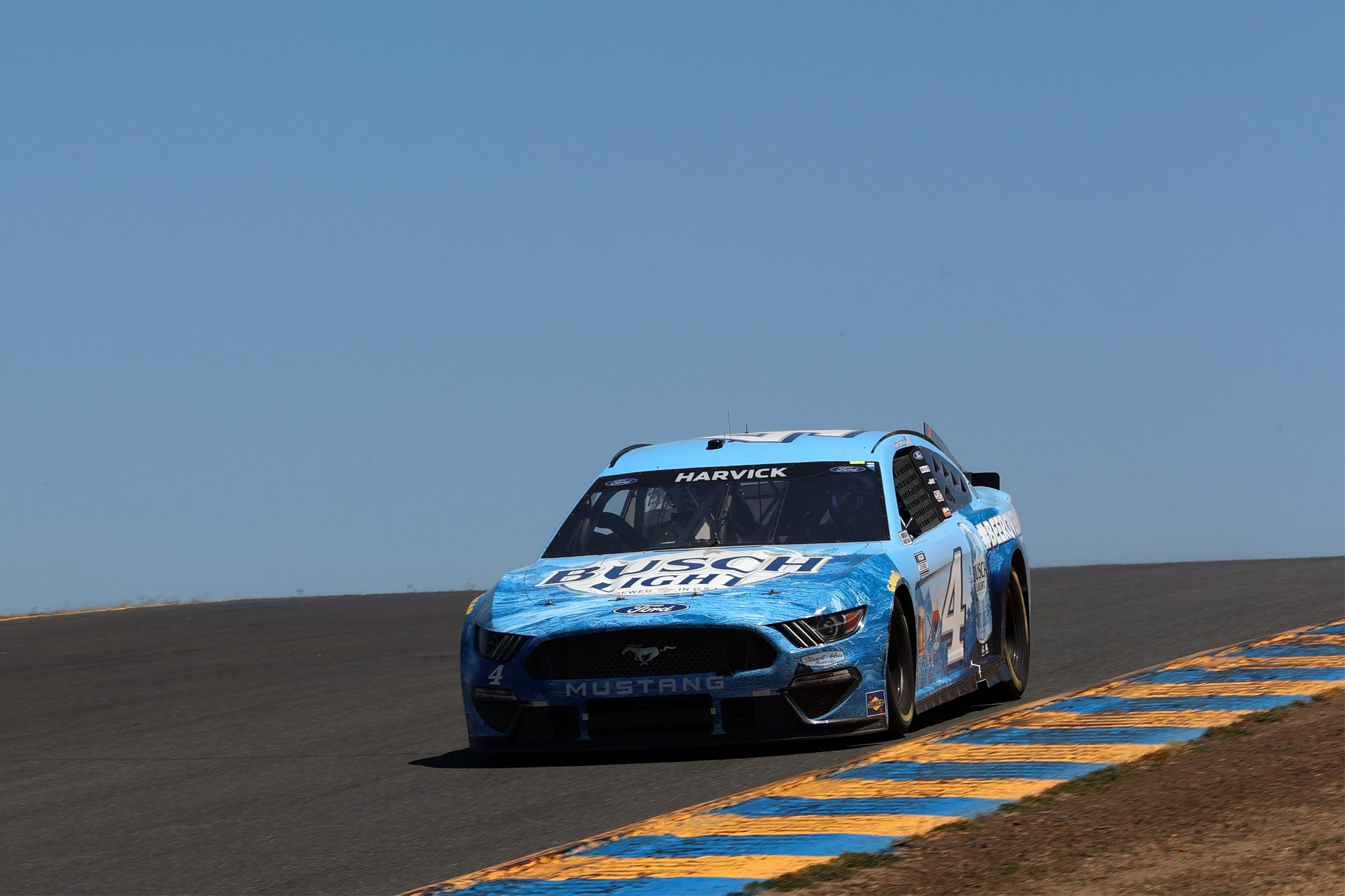 SONOMA, CALIFORNIA - JUNE 06: Kevin Harvick, driver of the #4 Busch Light #BeerOverWine Ford, drives during the NASCAR Cup Series Toyota/Save Mart 350 at Sonoma Raceway on June 06, 2021 in Sonoma, California. (Photo by Carmen Mandato/Getty Images) | Getty Images