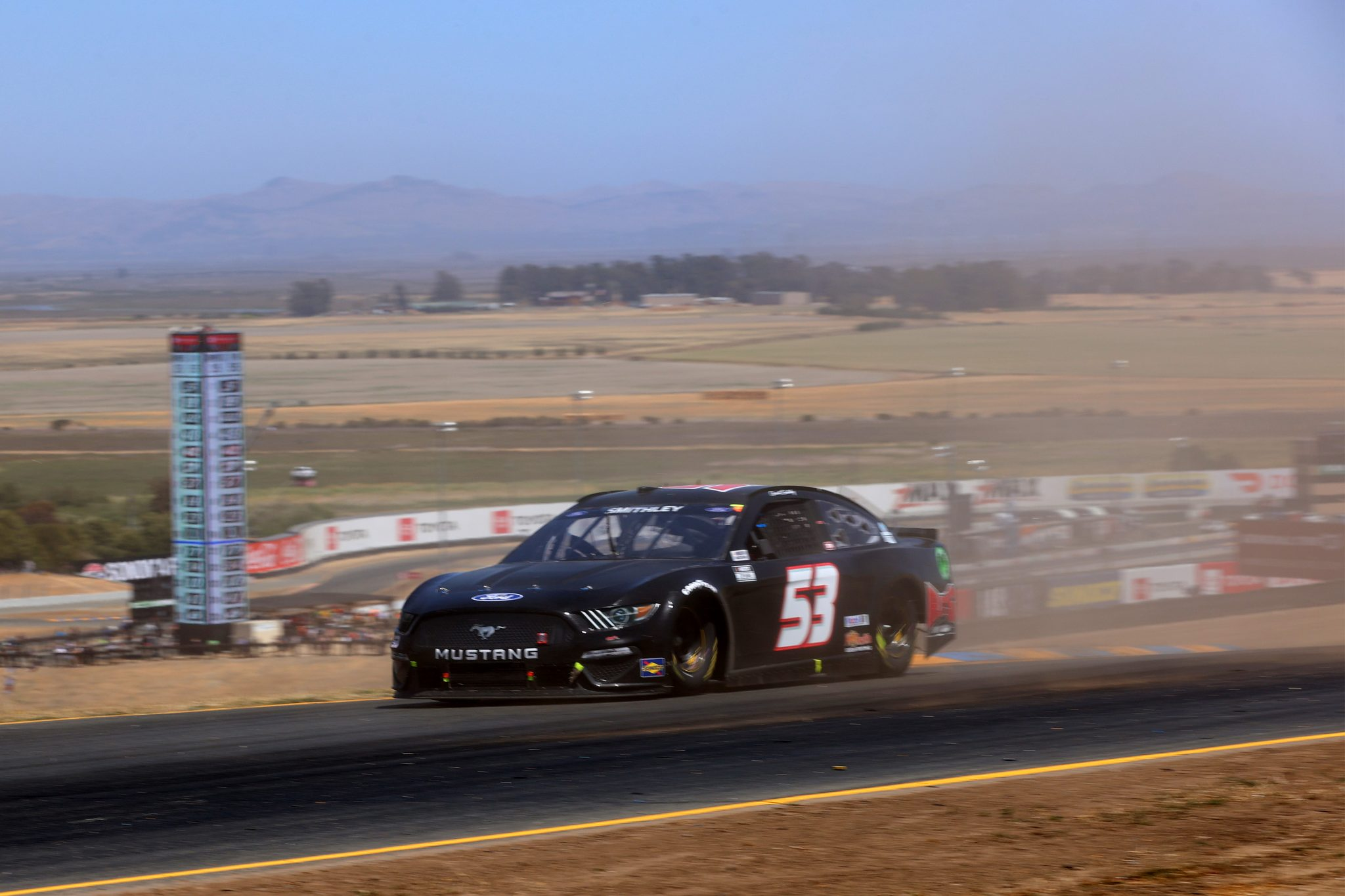 SONOMA, CALIFORNIA - JUNE 06: Garrett Smithley, driver of the #53 RJ's Paint Shop Ford, drives during the NASCAR Cup Series Toyota/Save Mart 350 at Sonoma Raceway on June 06, 2021 in Sonoma, California. (Photo by Carmen Mandato/Getty Images) | Getty Images