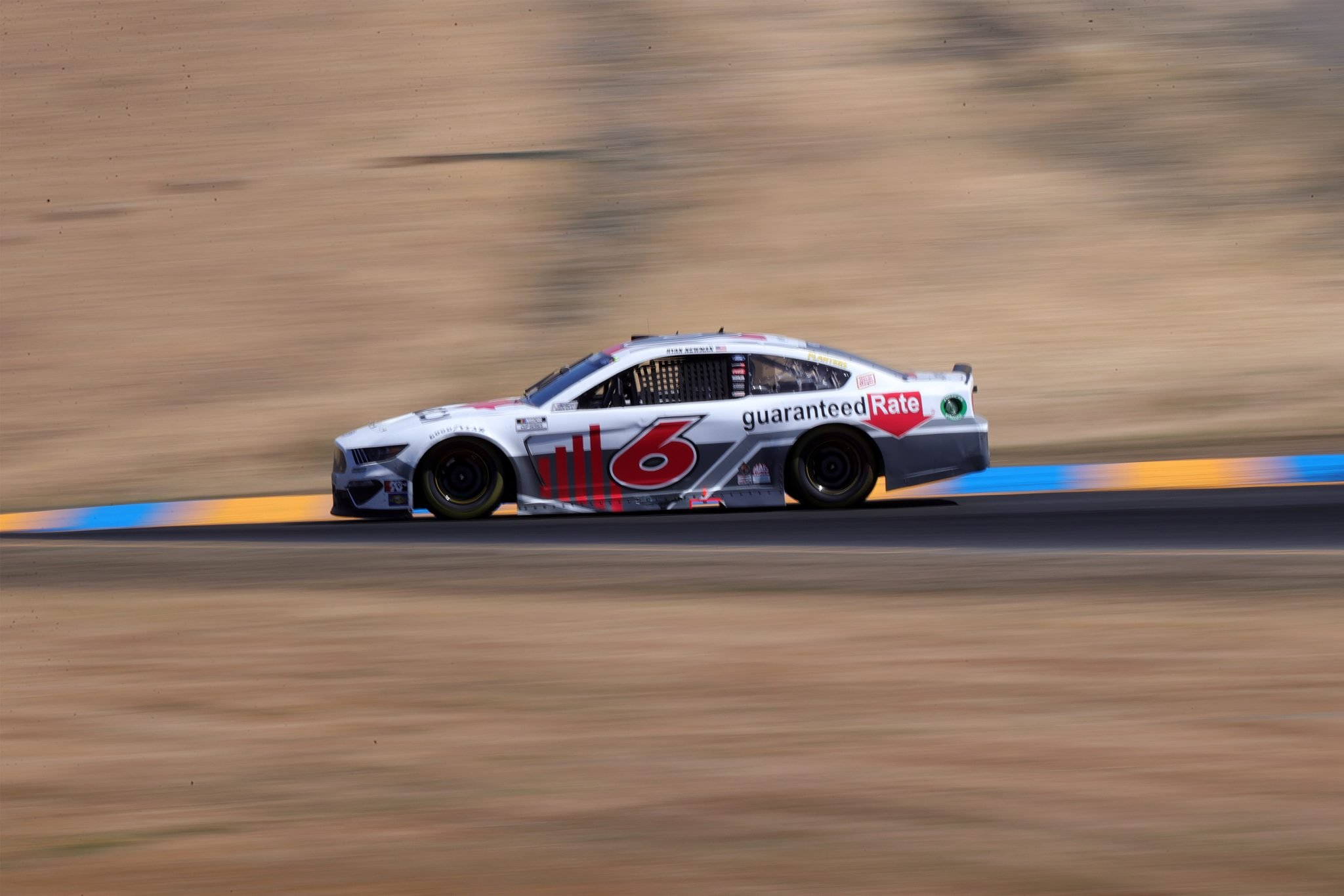 SONOMA, CALIFORNIA - JUNE 06: Ryan Newman, driver of the #6 Guaranteed Rate Ford, drives during the NASCAR Cup Series Toyota/Save Mart 350 at Sonoma Raceway on June 06, 2021 in Sonoma, California. (Photo by Carmen Mandato/Getty Images) | Getty Images